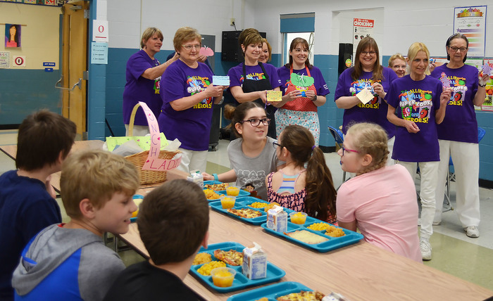Cayuga Heights Elementary food service helpers hold up candy gifts they received from fifth graders on Lunch Hero Day.
