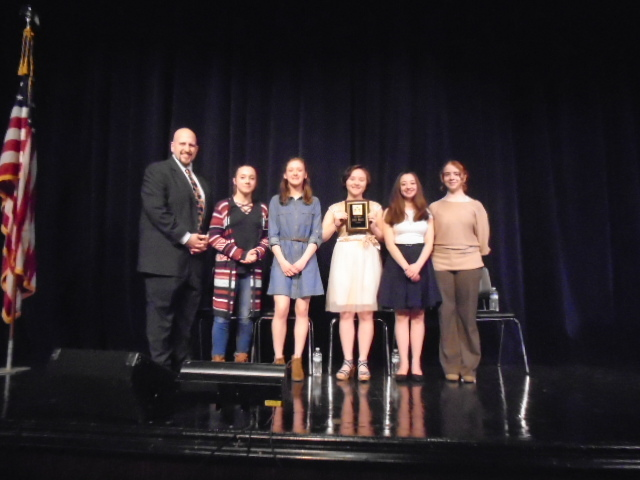 Teacher Sal Carlino and essay winners.