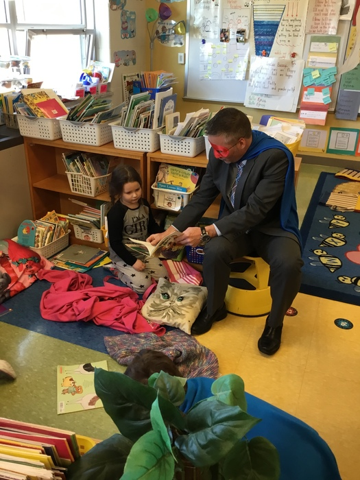 Dr. Rabey reading with kindergarteners